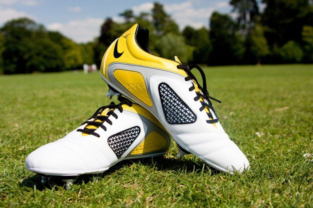 192 1921740 yellow football boots wallpaper mural football shoes on