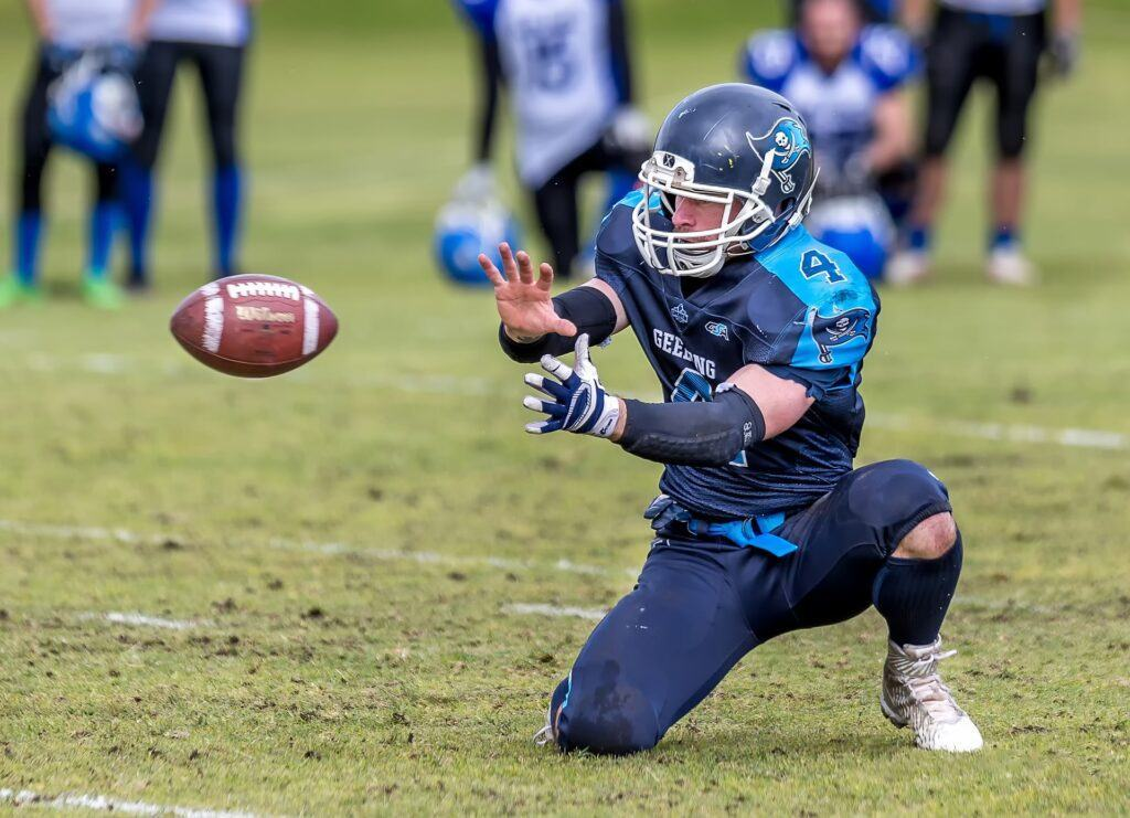 American football is played mainly by hand